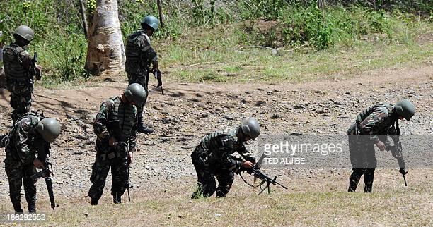 Philippine troops load their weapons as they simulate an ambush scenario during a squad live fire exercise as part of the annual joint PhilippineUS...