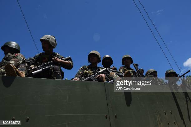 Philippine troops ride on their truck on their way to the frontline in the outskirts of Marawi on the southern island of Mindanao on June 28 2017...