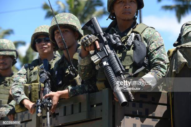 TOPSHOT Philippine troops ride on their truck on their way to the frontline in the outskirts of Marawi on the southern island of Mindanao on June 28...