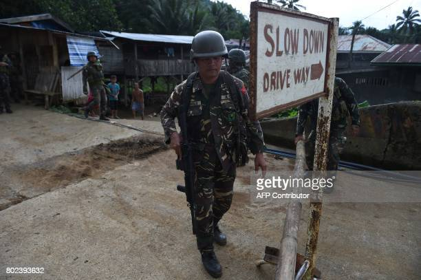 Philippine troops secure a bridge near the frontline in the outskirts of Marawi on the southern island of Mindanao on June 28 2017 Islamist militants...