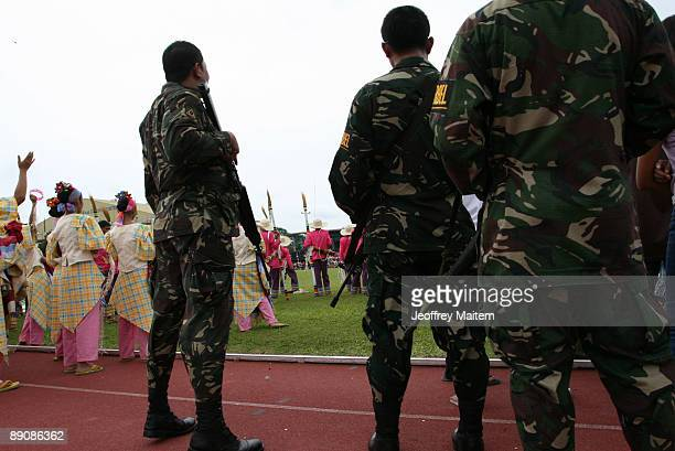 Philippine troops secure the 2009 T�nalak Festival showcasing South Cotabato Province tribal cultures on July 18 2009 in the southern city of...