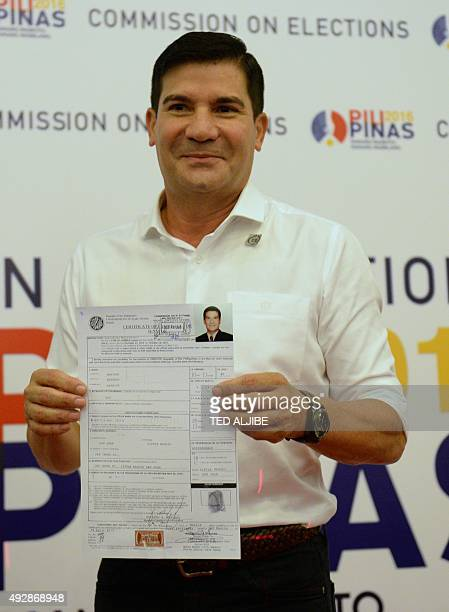 Philippine TV personality and film actor Edu Manzano shows his certificate of candidacy for senator at the Commission on Elections in Manila on...
