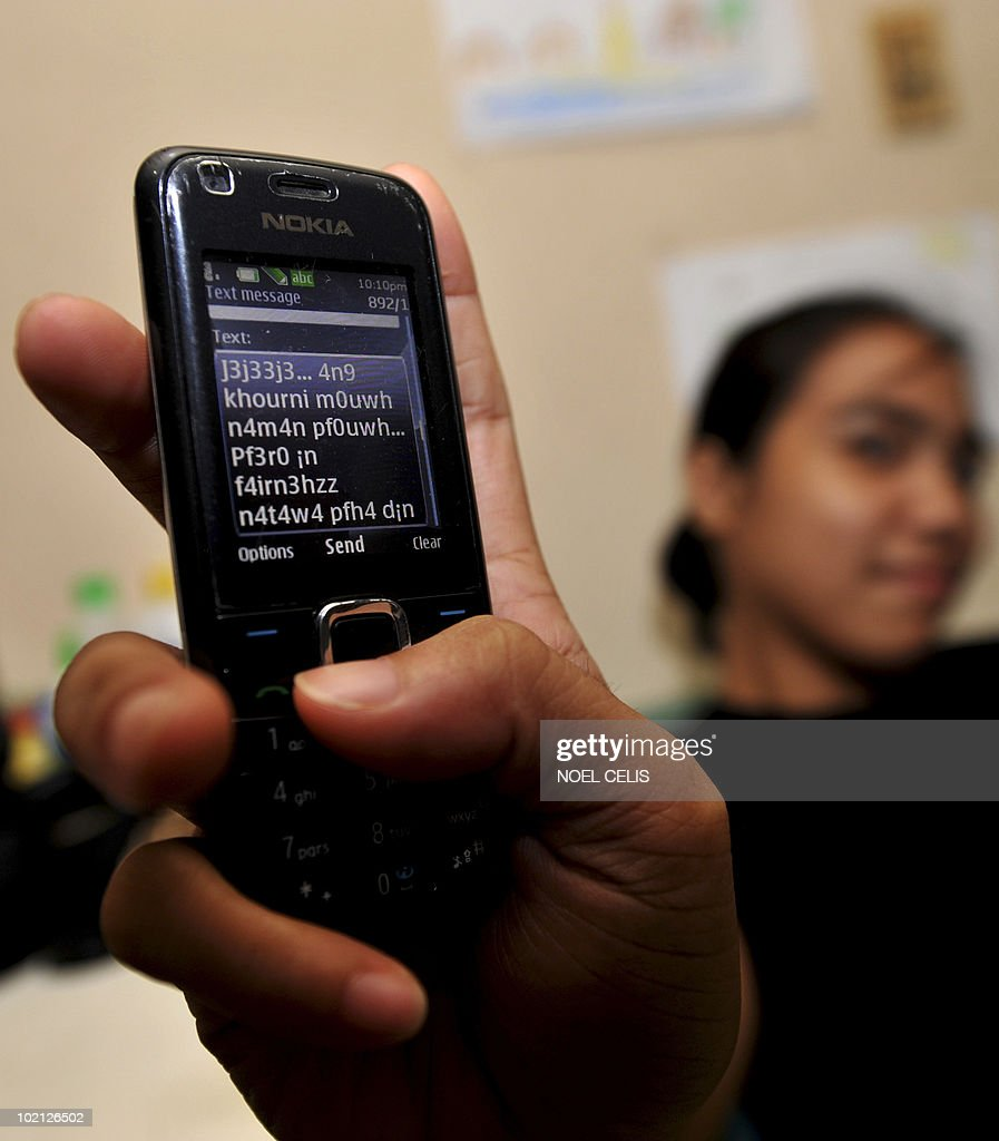 A Philippine woman shows her composed mobile phone text message in a cyber dialect called 'jejemon' in Manila on June 10, 2010. The Philippines is being overwhelmed by what authorities say is a language monster that has invaded youth speak in Internet social networks and mobile phone text messaging. The phenomenon has triggered enormous debate with the government declaring an 'all out war' against the cyber dialect, called 'jejemon', but with the Catholic church defending it as a form of free expression. The word 'jejemon' is derived from 'jeje' as a substitute for 'hehe' -- the SMS term for laughter -- and then affixing it with 'mon' -- taken from the popular Japanese anime of cute trainable monsters called 'Pokemon.'