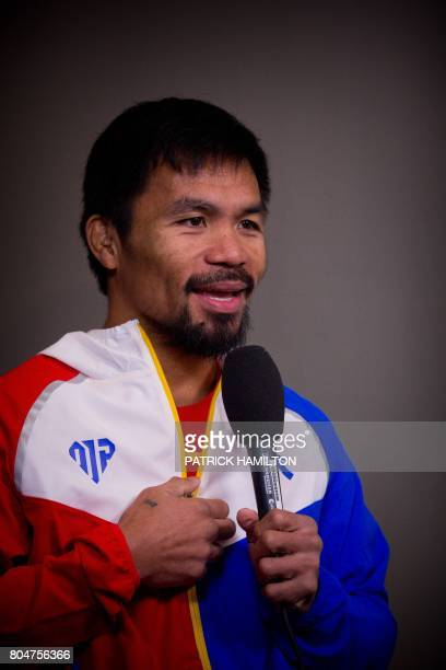 Philippine World Boxing Organization champion Manny Pacquiao conduct a television interview during the prefight weighin at Suncorp Stadium in...