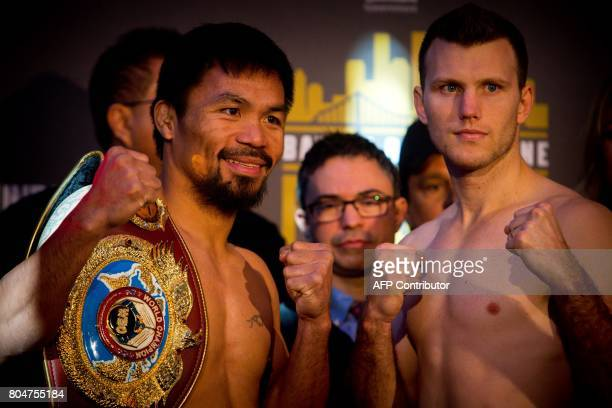 Philippine World Boxing Organization champion Manny Pacquiao poses for pictures with Brisbane contender Jeff Horn during the prefight weighin at...