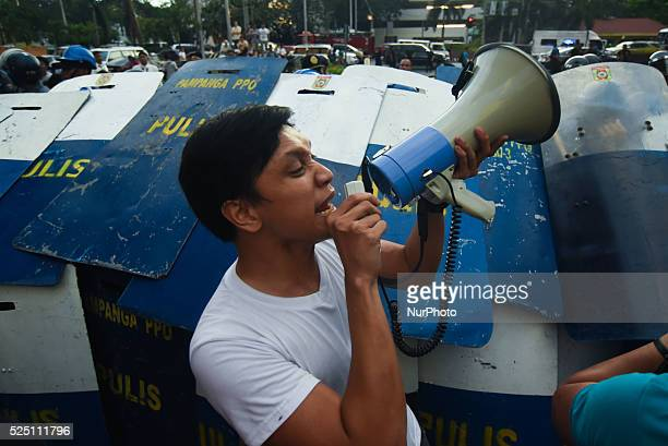 MANILA Philippines A protester leads a demonstration as members of militant group League of Filipino Students from various schools and universities...