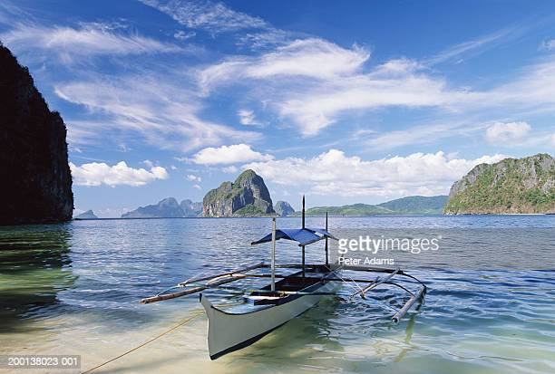 Philippines, Bacuit Archipelago, Palawan Island, moored outrigger boat