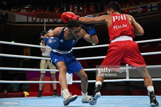 Philippines' Carlo Paalam and Britain's Galal Yafai fight during their men's fly boxing final bout during the Tokyo 2020 Olympic Games at the...