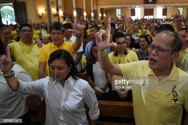 Philippine's current VicePresident Leni Robredo along with former president Benigno Aquino flash the Laban symbol used by the opposition during...
