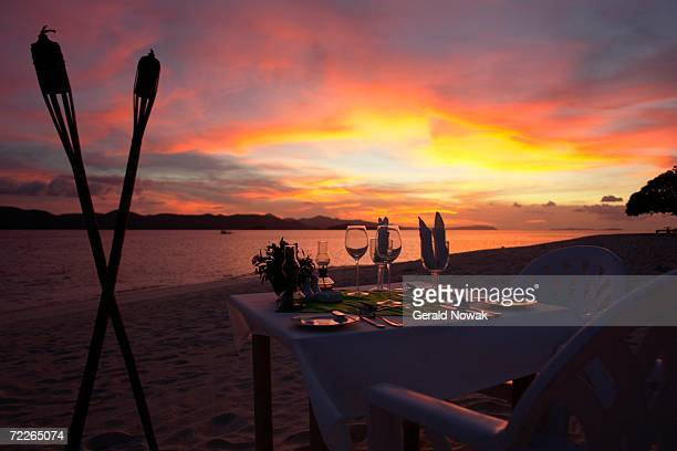 Philippines, Dining table on beach at sunset
