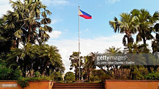 philippines flag raised on pole against sky - philippines flag stock pictures, royalty-free photos & images
