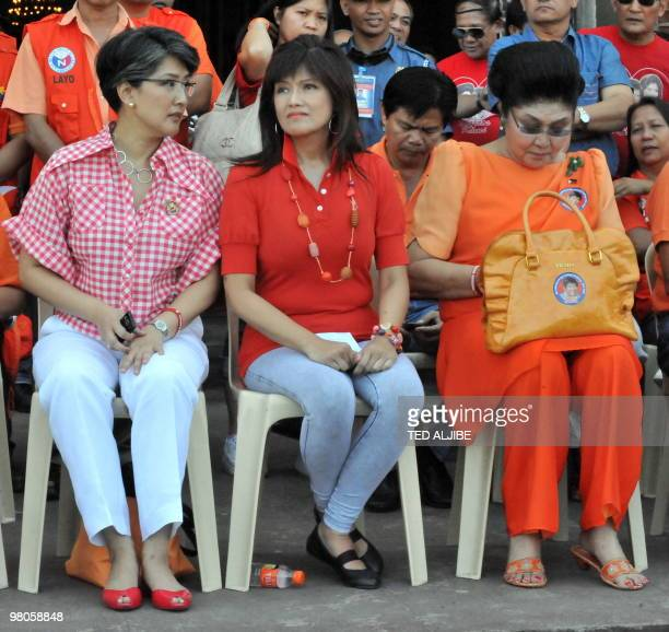 Philippines former first Lady Imelda Marcos sits with her daughters Imee and Irene after attending a mass at a church prior to her campaign sortie in...