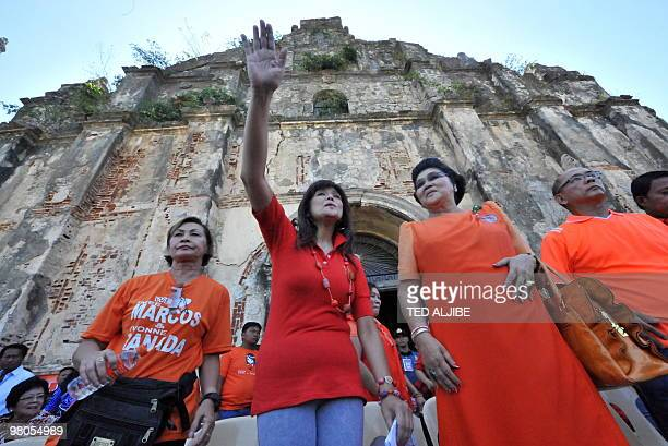 Philippines former first Lady Imelda Marcos walks with Imee during a campaign sortie in the town of Paoay Ilocos norte province north of Manila on...