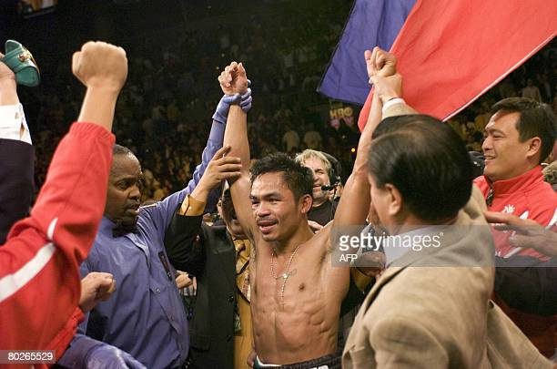 Philippines hero Manny Pacquiao celebrates capturing the World Boxing Council super featherweight crown after dethroning Mexico's Juan Manuel Marquez...