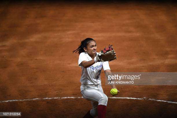 TOPSHOT Philippines' Kaith Ezra Jalandoni pitches during the women's preliminary softball match between the Philippines and Taiwan at the 2018 Asian...