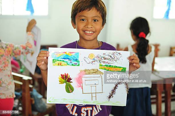 Philippines Leyte Ormoc Albuera Art in All of Us activities at the school in collaboration with the Red Pencil and the Red Cross children displaying...