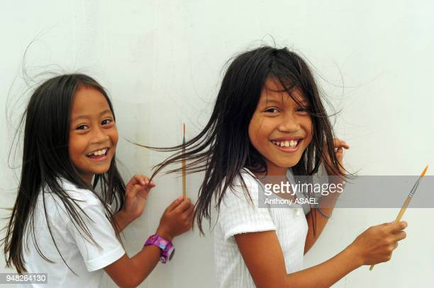Philippines Leyte Ormoc Albuera Art in All of Us activities at the school in collaboration with the Red Pencil and the Red Cross 2 girls playing with...