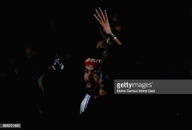 Philippine's Manny Pacquiao arrive at stage for their fight with Argentina's Lucas Matthysse during their World welterweight boxing championship...