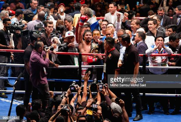 Philippine's Manny Pacquiao celebrated after winning fight with Argentina's Lucas Matthysse during their World welterweight boxing championship title...