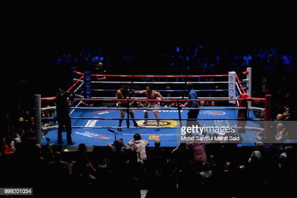 Philippine's Manny Pacquiao fight with Argentina's Lucas Matthysse during their World welterweight boxing championship title bout in Kuala Lumpur...