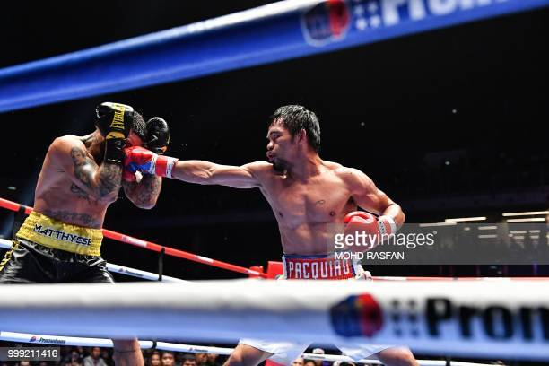 TOPSHOT Philippines' Manny Pacquiao fights Argentina's Lucas Matthysse during their world welterweight boxing championship bout at Axiata Arena in...