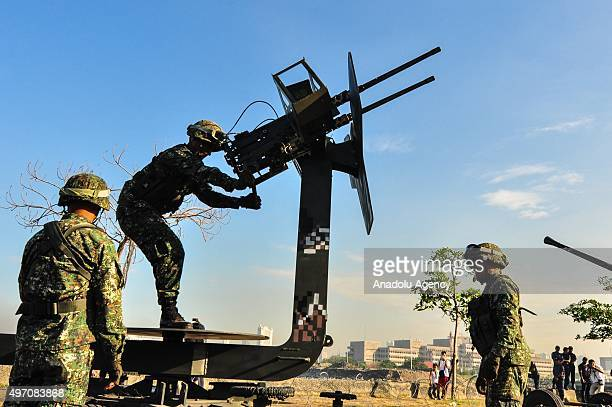 Philippines Marine soldiers adjust their antiaircraft guns deployed near the venue of the Asia Pacific Economic Cooperation Summit as part of the...