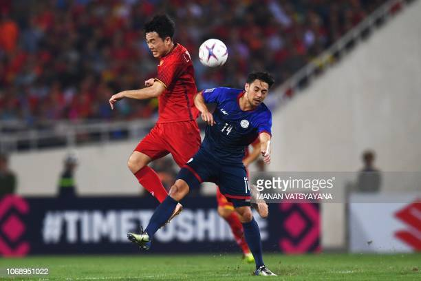 Philippines' midfielder Kevin Ingreso fights for the ball with Vietnam's midfielder Luong Xuan Truong during the second leg of the AFF Suzuki Cup...