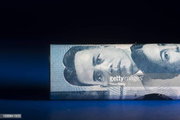 Philippines' peso banknotes are arranged for a photograph in Bangkok Thailand on Wednesday Sept 12 2018 The Philippine peso weakened a fifth straight...