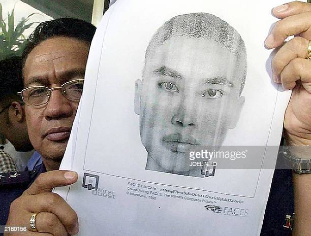 Philippines police investigation chief Eduardo Matillano shows a sketch of convicted Indonesian Jemaah Islamiyah terrorist Fathur Rohman alGhozi who...