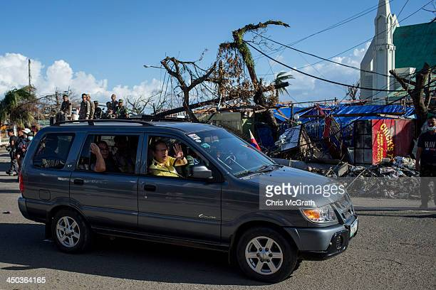 Philippines President Benigno Aquino III waves to people on the street as he tours destroyed areas of Tacloban City following the recent super...
