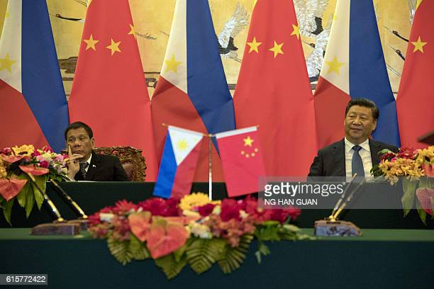 Philippines' President Rodrigo Duterte and his Chinese counterpart Xi Jinping attend a signing ceremony in Beijing on October 20 2016 Duterte met...