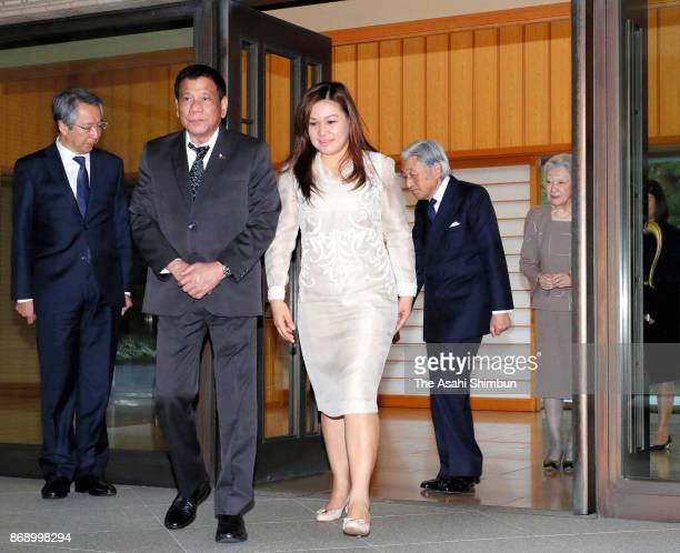 Philippines President Rodrigo Duterte and his partner Cielito Avancena are seen off by Emperor Akihito and Empress Michiko after their meeting at the...