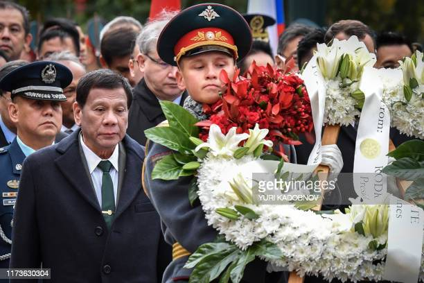 Philippine's President Rodrigo Duterte attends a wreath laying ceremony at the Tomb of the Unknown Soldier in central Moscow, on October 4 as part of...