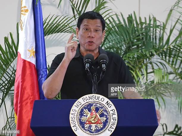 Philippines President Rodrigo Duterte delivers a speech at the Davao international airport terminal building early on September 30 shortly after...