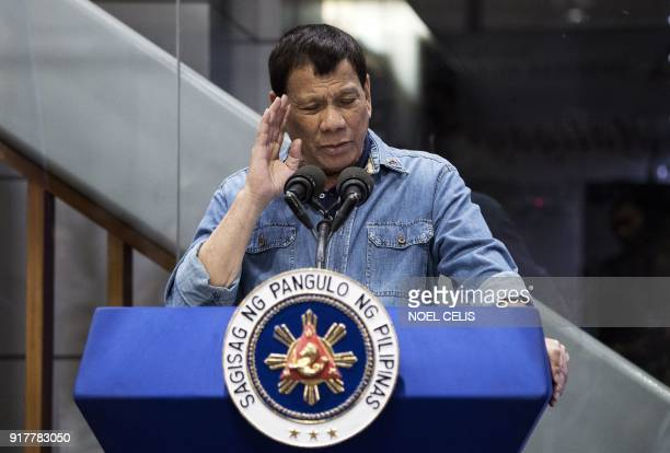 Philippine's President Rodrigo Duterte delivers his speech to overseas Filipino workers that arrived in Manila from Kuwait are at the Manila...
