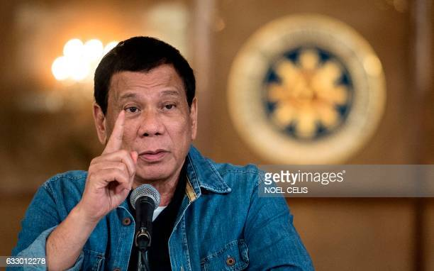 Philippine's President Rodrigo Duterte gestures as he answers a question during a press conference at the Malacanang palace in Manila on January 30,...