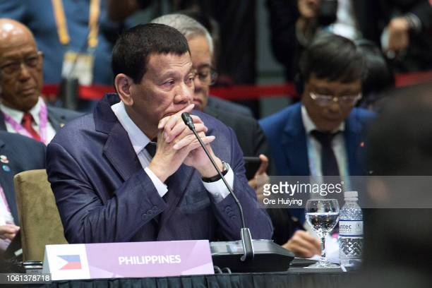 Philippine's President Rodrigo Duterte listens while Singapore's Prime Minister Lee Hsien Loong give his opening address during the ASEANChina summit...
