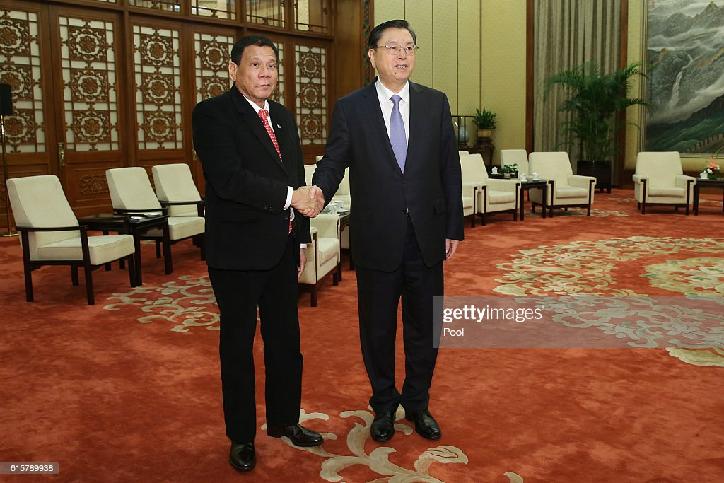 Philippines President Rodrigo Duterte (L) shakes hands with Zhang Dejiang, Chairman of the Standing Committee of the National People's Congress of China ahead of a meeting at the Great Hall of the People on October 20, 2016 in Beijing, China. Philippine President Rodrigo Duterte is on a four-day state visit to China, his first since taking power in late June, with the aim of improving bilateral relations.