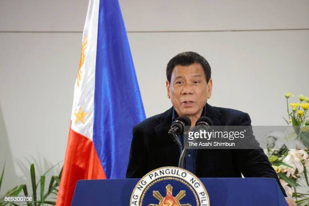 Philippines President Rodrigo Duterte speaks during a press conference on departure for Japan at Davao International Airport on October 29 2017 in...