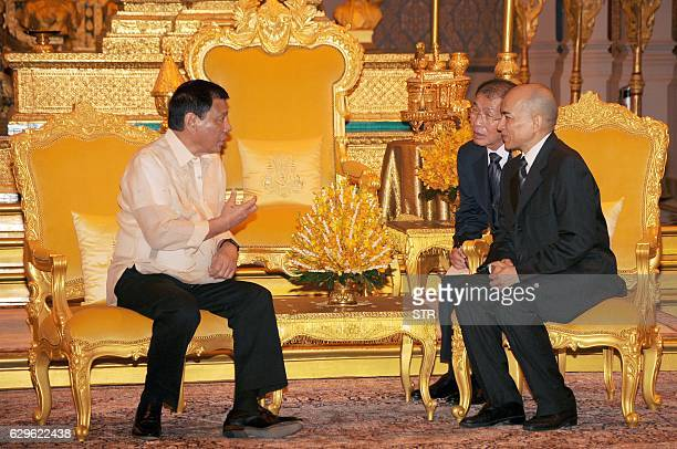 Philippines President Rodrigo Duterte speaks to Cambodian King Norodom Sihamoni during a meeting at the Royal Palace in Phnom Penh on December 14...