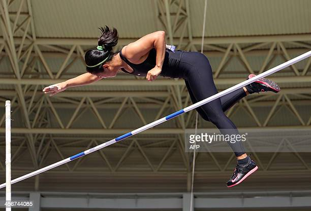 Philippine's Riezel Buenaventura competes in the women's pole vault final during the 27th Southeast Asian SEA Games in Naypyidaw on December 15 2013...