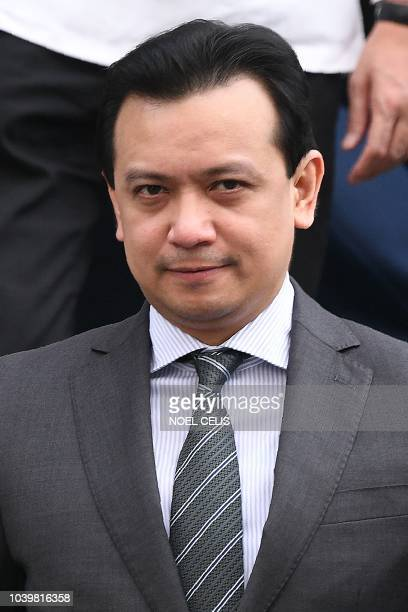 Philippines senator Antonio Trillanes leaves a police station after being arrested in Manila on Septbember 25 2018 Trillanes the chief critic of...