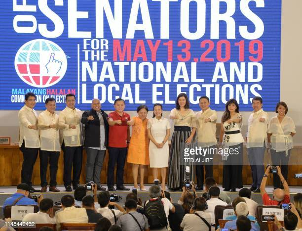 Philippines' Senatorselect and allies of President Rodrigo Duterte show the Duterte fist movie actor Bong Revilla Francis Tolentino movie actor Lito...