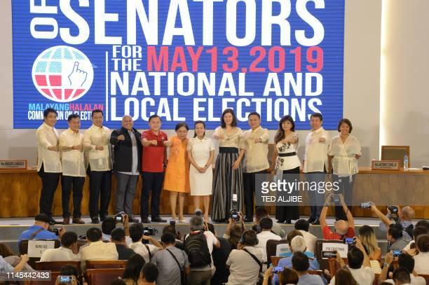 Philippines' Senatorselect and allies of President Rodrigo Duterte show the Duterte fist movie actor Bong Revilla Francis Tolentino movie actor Lito...