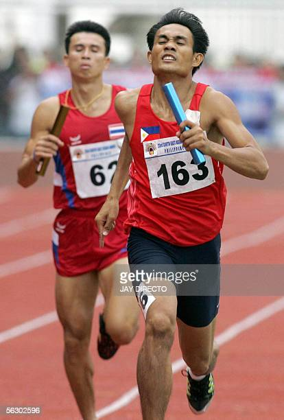 Philippines sprinter Ernie Candelrio sprints next to Banjong Lachua of Thailand during the finals of the Men 4x400 Relay of the 23rd South East Asian...