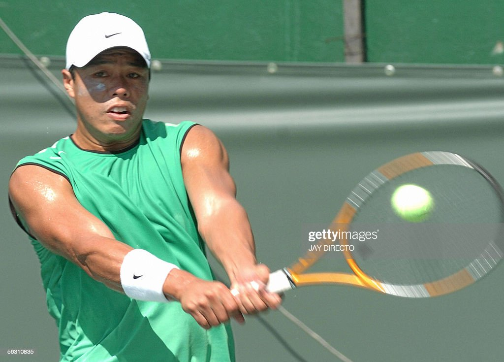 Philippines Tennis Player Cecil Mamit Hits A Return To Vivongsay