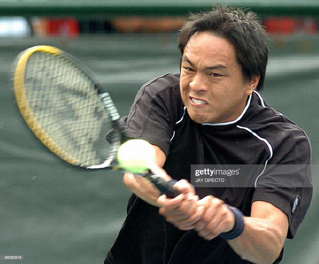 Philippines Tennis Player Eric Taino Hits Return The Ball To Suwandi