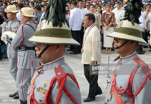 Philippines VicePresident Jejomar Binay watches as soldiers lay a wreath at the monument of Filipino National Hero Jose Rizal in Manila on June 12...