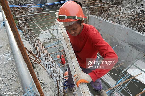 PhilippineseconomyinfrastructureFOCUS by Joel Guinto In this photo taken October 9 workers are working on one of about a hundred projects to control...