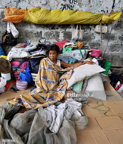 STORY 'PhilippineseconomypoliticsArroyoFOCUS' by Mynardo Macaraig Melanie Pulido a 44 year old mother of three and who has lived on a sidewalk for...